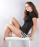 Woman With Bare Legs on Wicker Table Stock Image