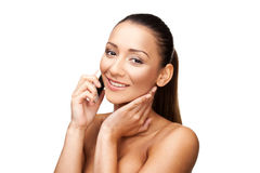Woman with bare shoulders on her mobile Royalty Free Stock Photos