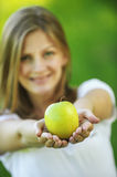 Woman with bare shoulders holding an apple Royalty Free Stock Image