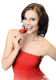 Woman with bare shoulders holding strawberry Royalty Free Stock Photography