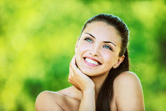 Woman with bare shoulders laughs Royalty Free Stock Photo