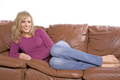 Woman barefoot on couch Royalty Free Stock Photo