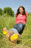 Woman is barefoot in a meadow Stock Photography