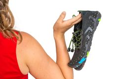 Woman with barefoot shoes over the shoulder stock images