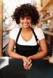 Portrait of female bartender in coffee shop royalty free stock photos