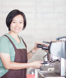 Woman barista at work in coffee shop Royalty Free Stock Images