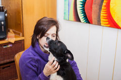 Woman with barking dog Stock Images