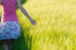 Woman in Barley Field Closeup Stock Photo