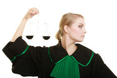 Woman barrister holding scales. Royalty Free Stock Photography
