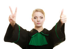 Woman barrister making sign victory thumb up gesture Royalty Free Stock Images