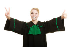 Woman barrister making sign victory thumb up gesture. Law court or justice concept. woman lawyer attorney wearing classic polish black green gown making ok sign royalty free stock photo