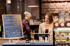 Free Woman Bartender At Cafe Or Coffee Shop Cashbox Stock Images - 94462984