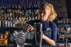 Woman bartender making an alcohol cocktail Royalty Free Stock Photo