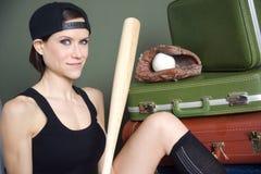 Woman with baseball bat glove ball luggage Royalty Free Stock Photos