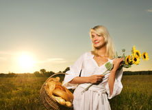 Woman with a basket Royalty Free Stock Photos