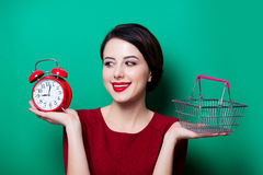 Woman with basket and alarm clock Stock Photo