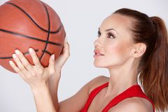 Woman with basket ball Stock Image