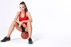 Woman with basket ball Stock Images