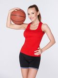 Woman with basket ball Royalty Free Stock Photo