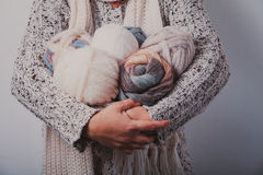 Woman with basket of balls woolen yarn Stock Photos