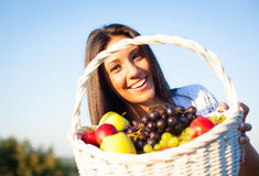 Woman with basket Stock Photos