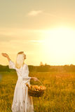 Woman with a basket of bread Royalty Free Stock Image
