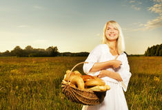 Woman with a basket of bread Royalty Free Stock Photo