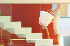 Woman with a basket climbing up stairs Stock Images