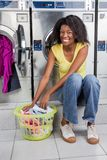 Woman With Basket Of Clothes In Laundry Stock Images