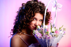 Woman with a basket of flowers Stock Photography