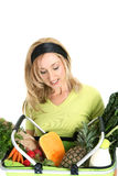 Woman with basket of food Royalty Free Stock Photos