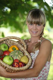 Woman with basket of fruit Royalty Free Stock Image