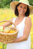 Woman with basket of fruit Royalty Free Stock Photos