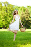 Woman with a basket of fruit in hand Royalty Free Stock Image
