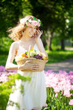 Woman with a basket of fruit in hand Royalty Free Stock Photography