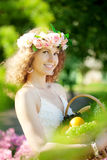 Woman with a basket of fruit in hand Stock Photos