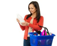Woman with basket full of cleansers Stock Photos