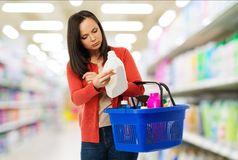 Woman with basket full of cleansers Stock Images