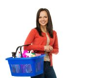 Woman with basket full of cleansers Stock Photography