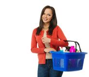 Woman with basket full of cleansers Royalty Free Stock Photography