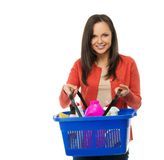 Woman with basket full of cleansers Royalty Free Stock Images