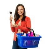 Woman with basket full of cleansers Royalty Free Stock Image
