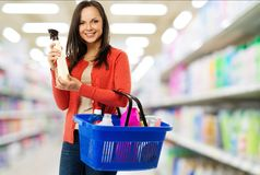 Woman with basket full of cleansers Stock Image