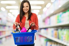 Woman with basket full of cleansers Royalty Free Stock Photos