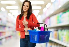 Woman with basket full of cleansers Royalty Free Stock Photo