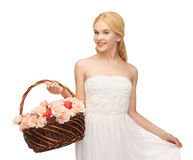 Woman with basket full of flowers Royalty Free Stock Photography