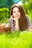 Woman with basket full of fruits Royalty Free Stock Image