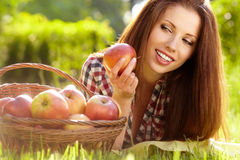 Woman with basket full of fruits Stock Image
