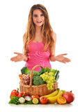Woman with basket full of vegetables and fruits Stock Photos