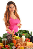 Woman with basket full of vegetables and fruits Royalty Free Stock Photo